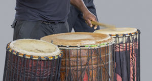 African drum player. Detail of a african drum player in grey back Stock Photos