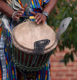 African drummer. Performs, this is a detail of hands beating the drum Stock Images