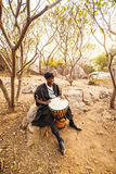 African drummer. In costume playing  music Royalty Free Stock Images