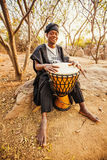 African drummer. In costume playing  music Royalty Free Stock Photos