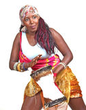 African drummer plays small djembe drum. An African drummer woman plays a small djembe drum, set against a white background Stock Photos