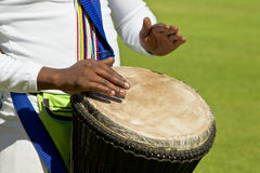 African drummers hand and drum. African drummers hands playing a skin covered traditional drum Stock Photo