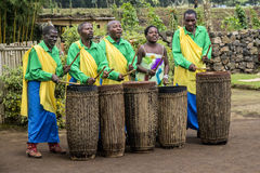 African drummers. MUSANZE, RWANDA - Tribal Drummers of the Batwa Tribe Perform Traditional Intore Dance to Celebrate the Birth of an Endangered Mountain Gorilla Stock Photos