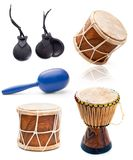 African drums and percussion. Collage photos of African drums and percussion isolated on white background stock images