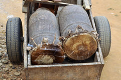 AFRICAN DRUMS SACRED. African drums are sacred and should not be touched by hand. This explains its transport into the carriage Stock Images