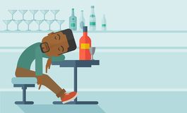 African Drunk man fall asleep in the pub Royalty Free Stock Photo