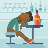 African Drunk man fall asleep in the pub Royalty Free Stock Image