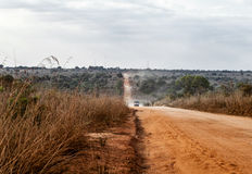 African dusty road. Dusty african road, on the way from Nampula to Island of Mozambique Royalty Free Stock Photography