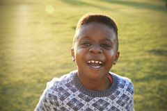 African elementary school boy laughing to camera outdoors Stock Photography