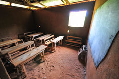 African Elementary School Classroom. Interior of an elementary school classroom in the Yilo Krobo District not far from Accra, Ghana. Dirt floor. Mud baked stock photography