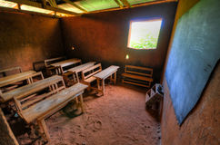 African Elementary School Classroom. In a clay building with dirt floors Stock Photos