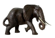 African elephant. Woodcarving of an African elephant, isolated on white Stock Photo