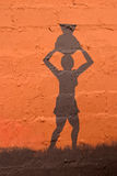 African ethnic background. Illustration depicting an African woman carrying a clay pot on her head stock photography