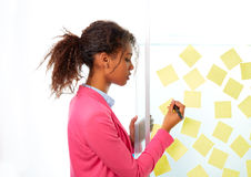 African ethnic executive with stickers in office Royalty Free Stock Image