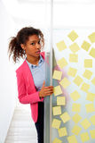 African ethnic executive with stickers in office Stock Photography