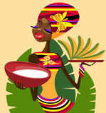 African ethnic food. Portrait of Africans that holds trays of ethnic food Royalty Free Stock Photos