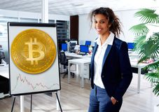 African ethnic woman in Bitcoin presentation board. At office Royalty Free Stock Photos