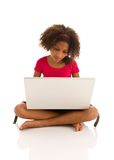 African ethnicity girl working on laptop Royalty Free Stock Images