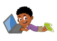 Little boy on laptop. African ethnicity kid lying on the floor using laptop computer Stock Images