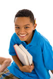 African ethnicity teenage boy with two books Stock Photo