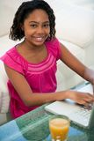 African ethnicity teenager with laptop Stock Image