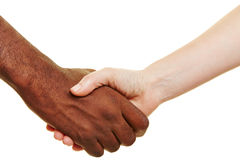 African and European shaking hands Stock Photos