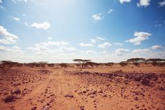 African expedition. Safari and extreme travel in Africa. Drought mountain landscape with dust off road in offroad car expedition stock images