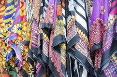 African Fabrics. Bright African print fabrics for sale in the market stock images