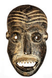 African Face mask. Wooden carved African tribal mask, dark wood with painted face. Isolated on black  background. Congo, Africa Royalty Free Stock Photo