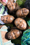 African family. Lying on grass stock photos