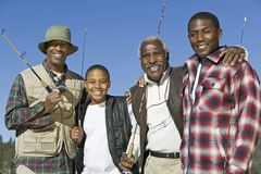 African Family With Fishing Rods Royalty Free Stock Image
