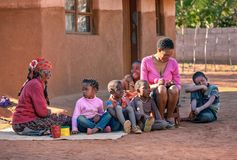 African family in front of the house. In the village, Botswana Stock Images