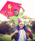African Family Happiness Holiday Vacation Activity Concept.  stock images