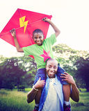 African Family Happiness Holiday Vacation Activity Concept.  royalty free stock images