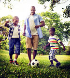 African Family Happiness Holiday Vacation Activity Concept.  Stock Photo