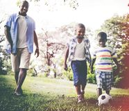 African Family Happiness Holiday Vacation Activity Concept stock photos