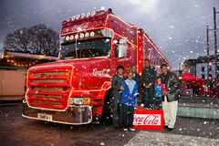 African family pose with Coca-Cola Christmas truck Royalty Free Stock Images