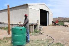 African Farmer. An African man farmer works on a farm in the Karoo, South Africa royalty free stock photo