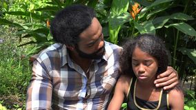 African Father and Daughter Talking