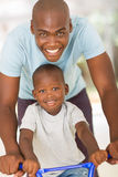 African father son bike Royalty Free Stock Photos