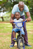 African father son bike Royalty Free Stock Photo