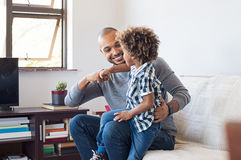 African father and son playing stock photo