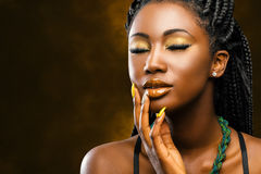 African female beauty portrait with eyes closed. Close up studio portrait of attractive young african woman with long braided hair.Girl with eyes closed stock photos