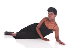 African female in black dress laying down Stock Image