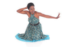 African female in a blue dress dancing Stock Photos
