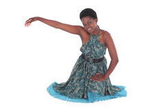 African female in a blue dress dancing Stock Photo