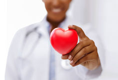 African female doctor with red heart royalty free stock image