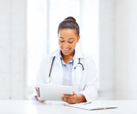 African female doctor with tablet pc Royalty Free Stock Image