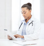 African female doctor with tablet pc royalty free stock photos