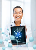 African female doctor with tablet pc and molecules. Healthcare, hospital, research, science and medical concept - african female doctor with tablet pc and stock image